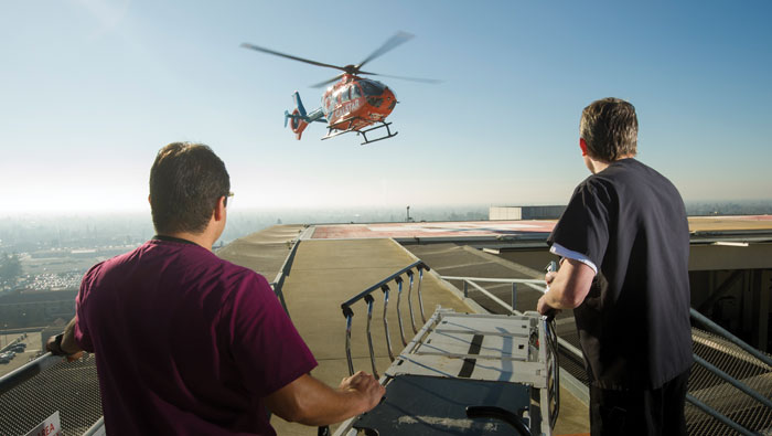 A Life Flight helicopter approaches the medical center roof