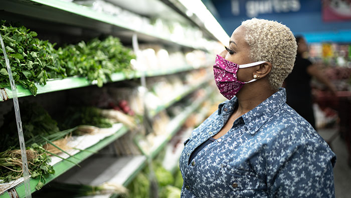 Woman in mask at grocery store