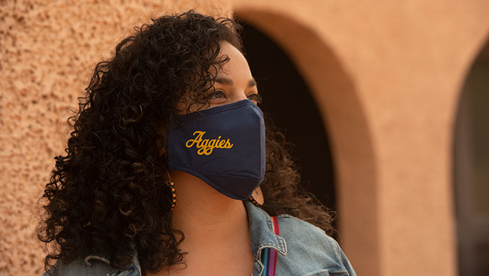 UC Davis student in an Aggies face mask