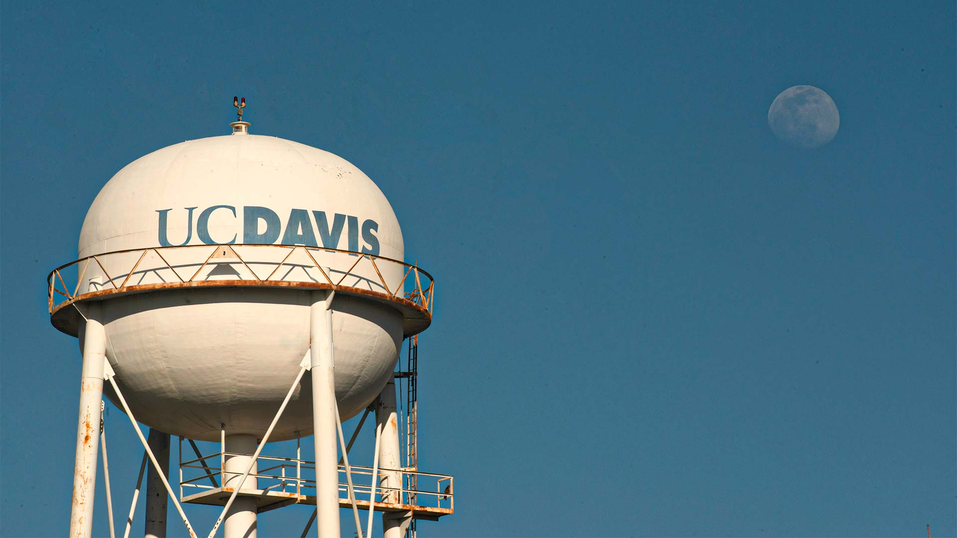 UC Davis water tower with moon