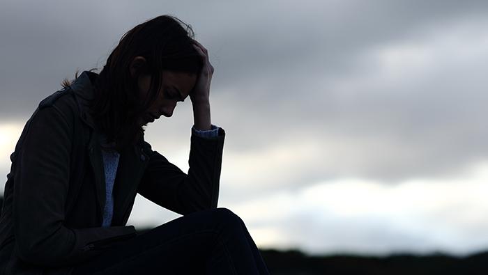 Silhouette of sad woman